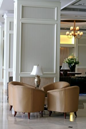 Elegant waiting area living room with sofas