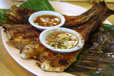 Spicy grilled rayfish traditional asian cuisine