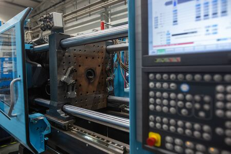 Photo pour Huge injection molding machine without fixture, ready for the plastic articles by injecting heated material into mold, automotive industry - image libre de droit