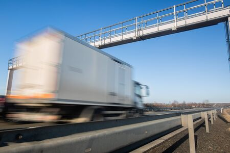 Photo for Truck passing through a toll gate on a highway, highway charges - Royalty Free Image