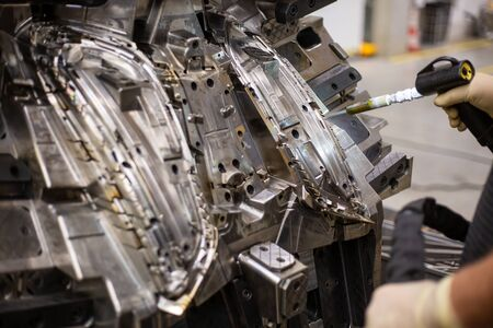 Photo pour Engineer freezing injection mold after production by dry nitrogen - image libre de droit