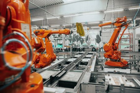 Stopped automatic arm robots in automotive due to economic crisis, the global economic crisis in industry, industrial concept