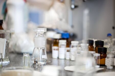 Photo pour Flasks with liquids in a lab, pharmaceutical industry factory and production laboratory - image libre de droit