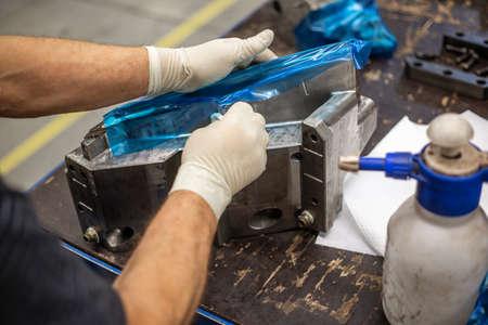 Photo pour Process of maintenance a parts of a huge mold for plastic moldings, industrial concept - image libre de droit