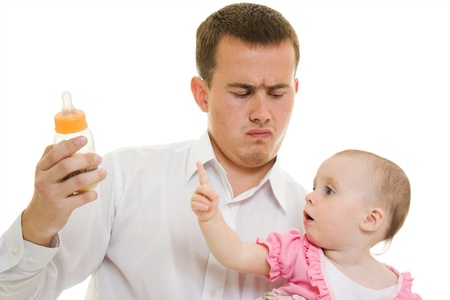 A young father with a baby on a white background.