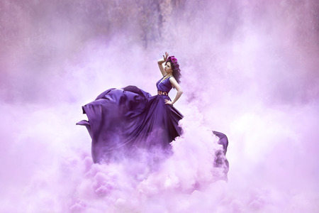 Foto für Lady in a luxury lush purple dress swirls in the smoke,fantastic shot,fairytale princess is walking in the autumn forest,fashionable toning,creative computer colors - Lizenzfreies Bild