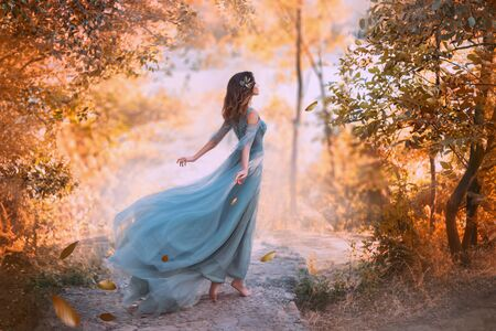 Photo pour Beautiful woman wearing blue turquoise dress in the forest - image libre de droit
