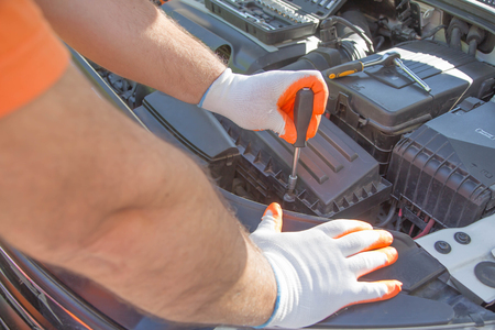 Photo pour Auto mechanic working in garage during the maintenance of engine. repairing car in auto service - image libre de droit