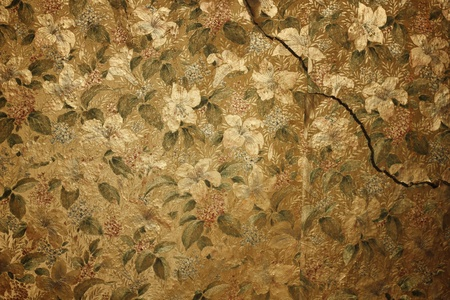 vintage floral wallpaper on cracked wall