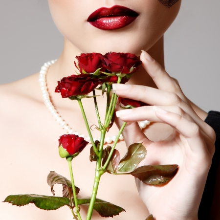 Beautiful woman with dark red roses flower in veil retro glamour beauty portrait. Face closeup