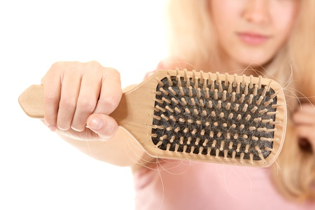 women with hair broblem holding loss hair comb in hand, isloated on white background