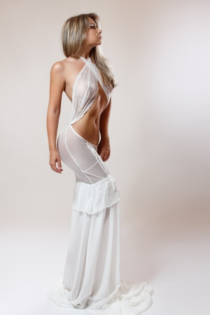 young sexy woman in white trendy dress, studio shot