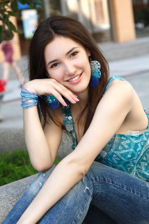 Outdoors street portrait of beautiful young brunette teen girl