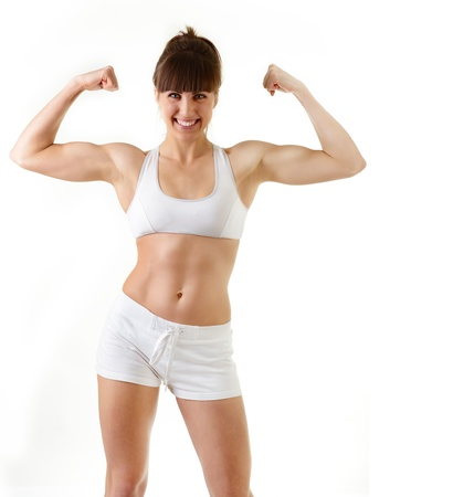 sport young woman with perfect body showing bicepses, fitness girl studio shot over white background