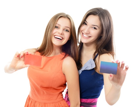 beautiful friendly smiling confident young women showing club cards in hands, over white backgroundの写真素材