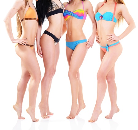 girls in bikini, four attractive caucasian young women in swimsuits over white