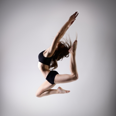 young beautiful dancer teen girl dancing and jumping, studio series