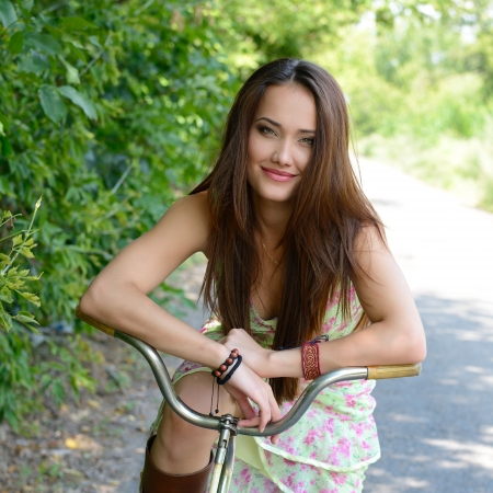 Happy young beautiful woman with retro bicycle, summer outdoor