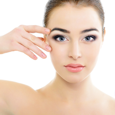 beautiful woman's face with accent on eyes, eye scanning technology, health care, over white