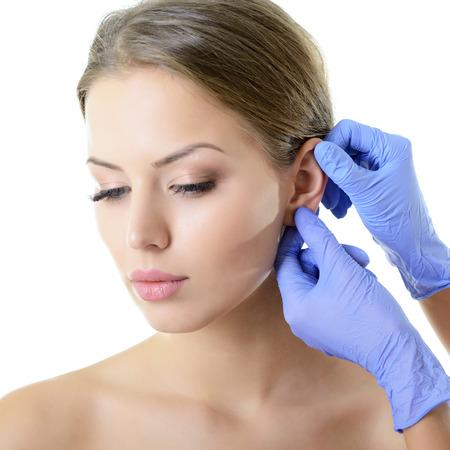 Foto für Young woman face with beauty treatment ear plastic isolated  - Lizenzfreies Bild
