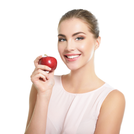 Photo for Beauty female portrait. Young attractive woman posing at studio with apple over white background. Beautiful girl with perfect smile. Model with perfect make-up - Royalty Free Image