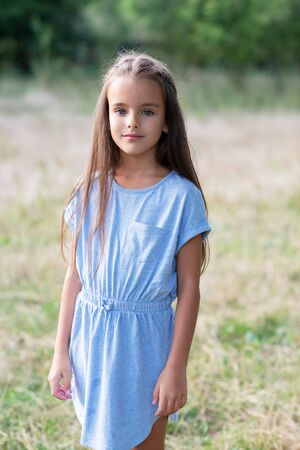 Photo pour Pretty little girl posing summer nature outdoor in blue dress. Kid's portrait. Beautiful child's face - image libre de droit