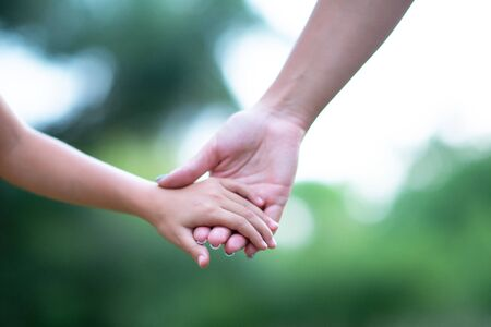 Photo for Woman's and kid's hands. Mother leads her child, summer nature outdoor. Parenting, togetherness, help, union, childhood, trust, family concept. - Royalty Free Image