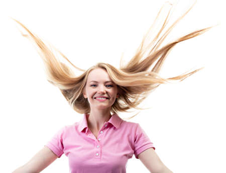 Foto de Happy smiling excited comical surprised young charming woman with long flying blond hair over white background. - Imagen libre de derechos