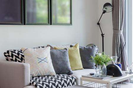 Foto de modern living room with row of pillows on sofa at home - Imagen libre de derechos