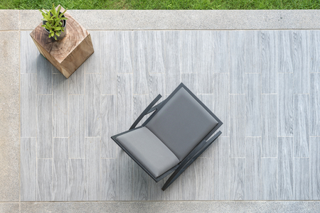 Photo pour modern grey leather chair with vase of plant on terrace, top view - image libre de droit