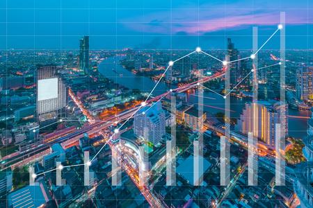 Photo pour Conceptual of business image with financial charts and graphs on blur cityscape as background, vintage style process - image libre de droit