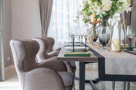Foto de classic dining room with wooden table and chair, interior design concept decoration - Imagen libre de derechos