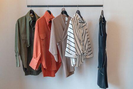 Photo pour modern wardrobe with set of clothes hanging on rail, modern closet interior design concept - image libre de droit