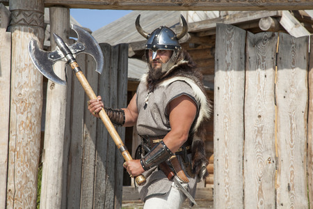 strong real Viking outside his home