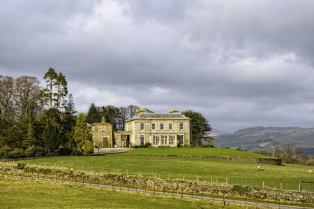 Scenic view of luxurious manor house on countryside estate, England