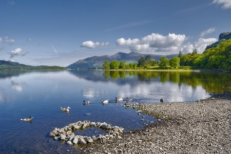 Scenic view of Derwent Water lake with Skiddaw mountain in background, Lake District National Park, Cumbria, England.