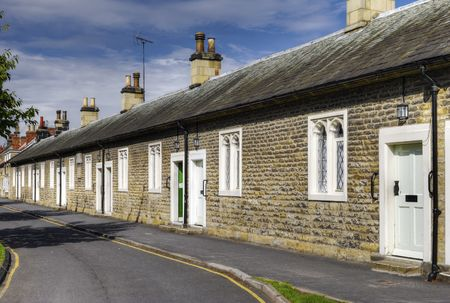 Row of 17th century historic almshouses in village of Thornton-le-Dale, North Yorkshire, England.