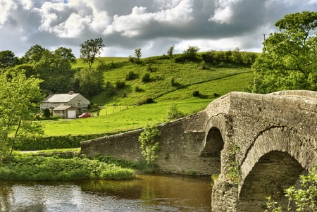 An ancient packhorse bridge on the river Lune near Beck Foot, Cumbria.