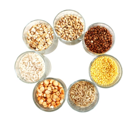 Different kinds of grain, rice, peas, rye, millet, an oats, millet, barley.