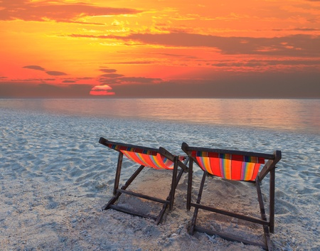 couples chairs beach on sand beach with colorful sky