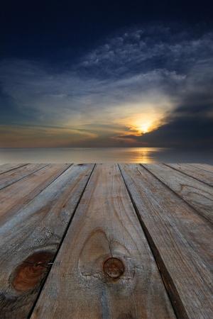 Foto de wood terrace perspective and sun set dark dusky colorful - Imagen libre de derechos