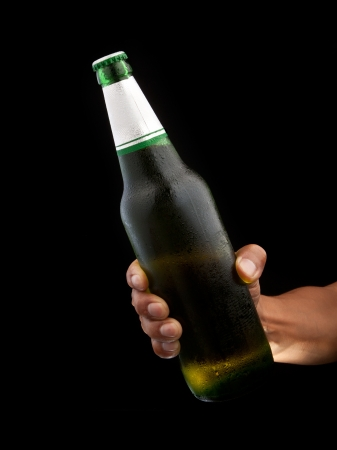 beer bottle in hand  with black background