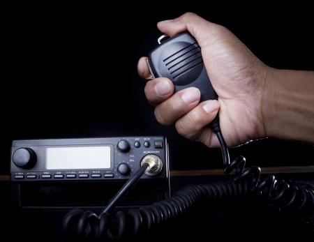 hand of Amateur radio holding speaker and press for radio communication theme