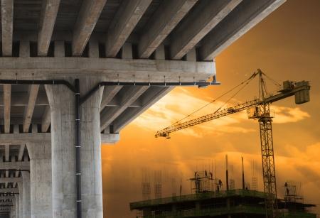 Photo pour urban development by big crane building construction  with beautiful sky in evening scene - image libre de droit