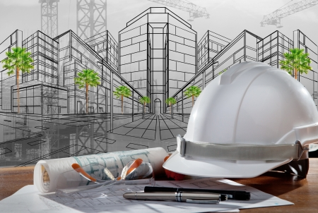 Photo for file of safety helmet and architect pland on wood table with sunset scene and building construction - Royalty Free Image