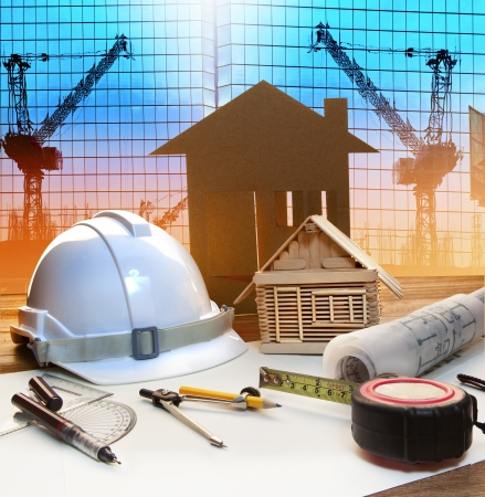 Photo pour office tower and home construction plan on architect working table with modern building and crane background use for civil engineer and architectural backdrop scene  - image libre de droit