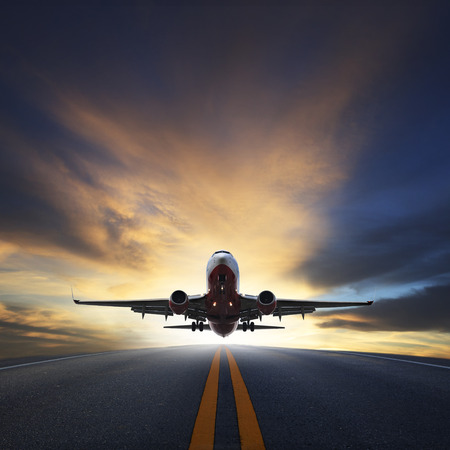 Foto de passenger plane take off from runways against beautiful dusky sky with copy space use for air transport ,journey and traveling industry business - Imagen libre de derechos