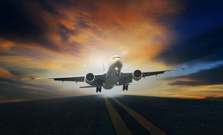passenger plane take off from runways against beautiful dusky sky with copy space
