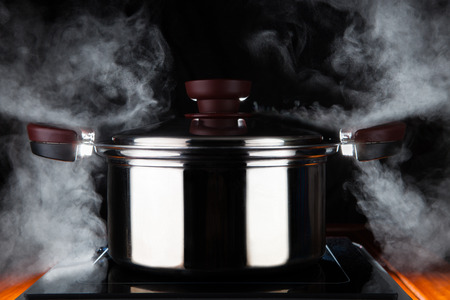 cooking food with hot stream power of stanless steel pot on electric magnet stove use for kitchen and meal preparing theme