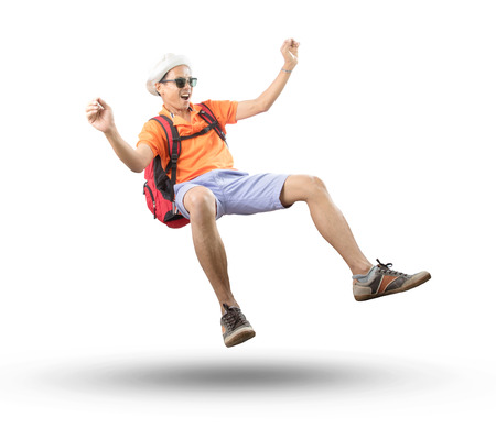 portrait of young asian traveler man floating mid air with crazy acting isolated white background use for people emotion ,active and happy holiday vacation
